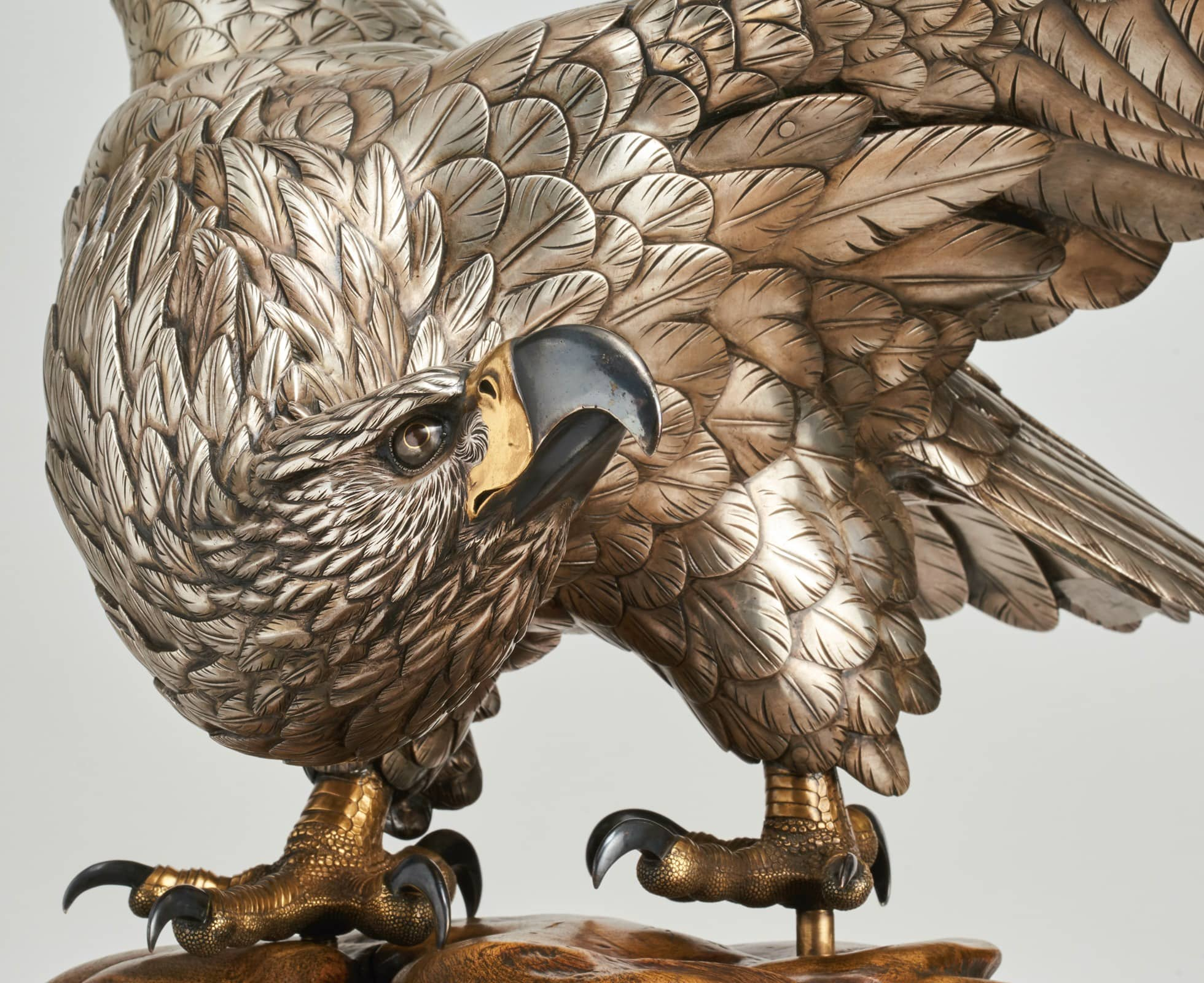Silvered bronze eagle on a rootwood base